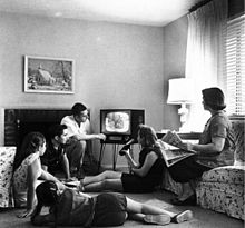 220px-Family_watching_television_1958